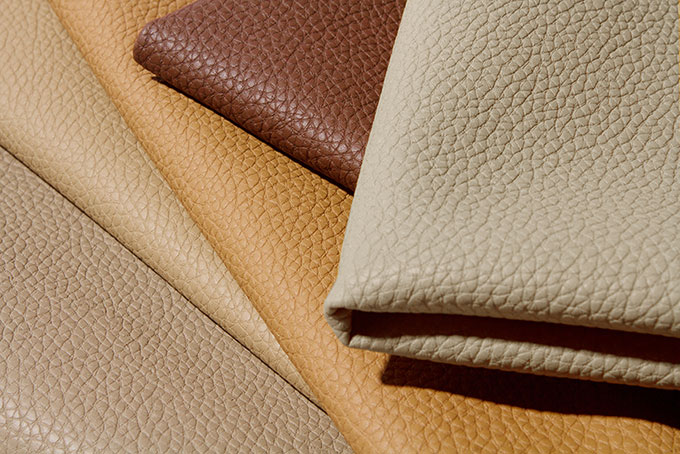 Pebbled faux-leather upholstery.